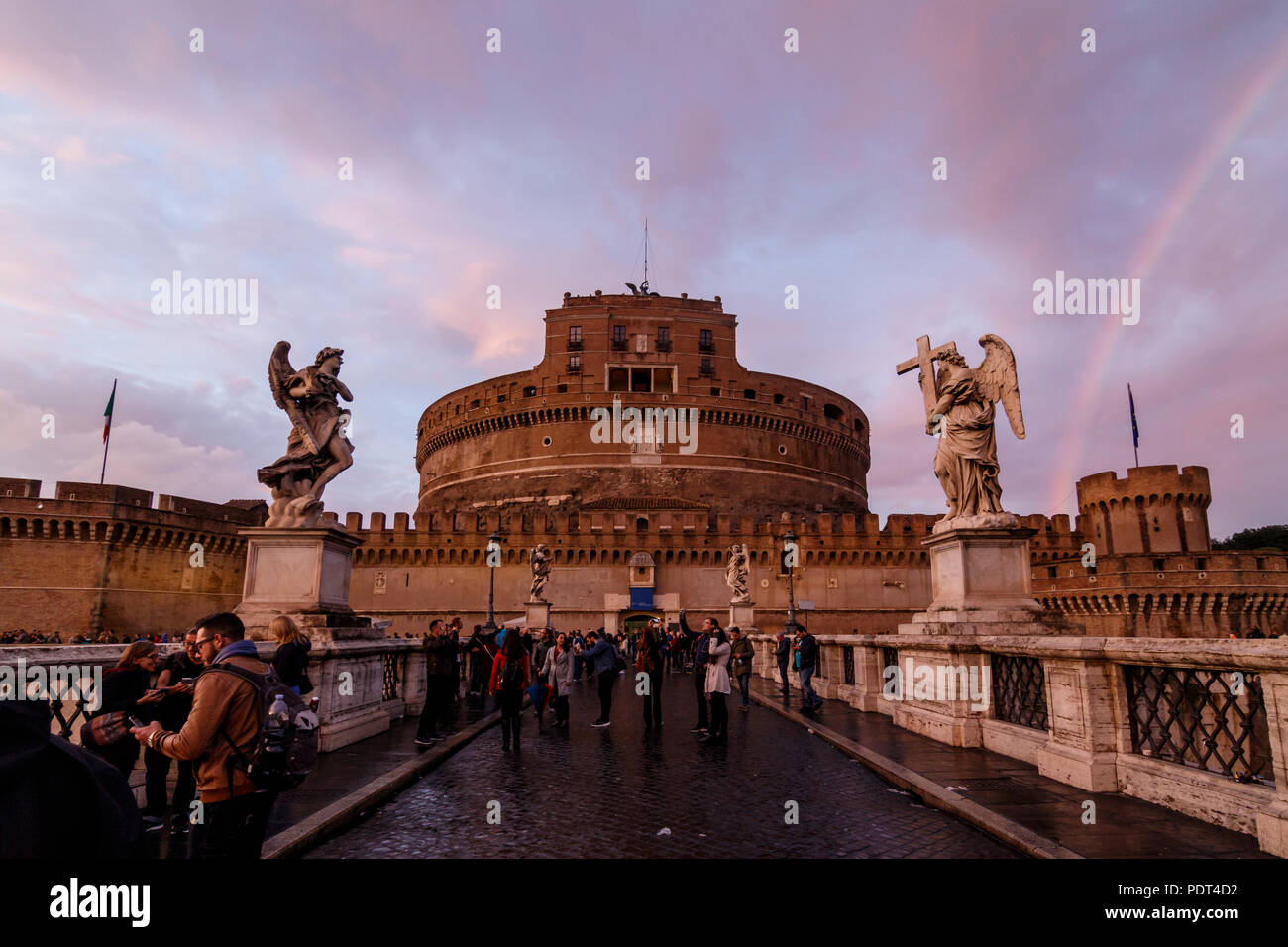 A St Angelo's Castle view in golden hour with a rainbow. Rome, Italy. - Stock Image