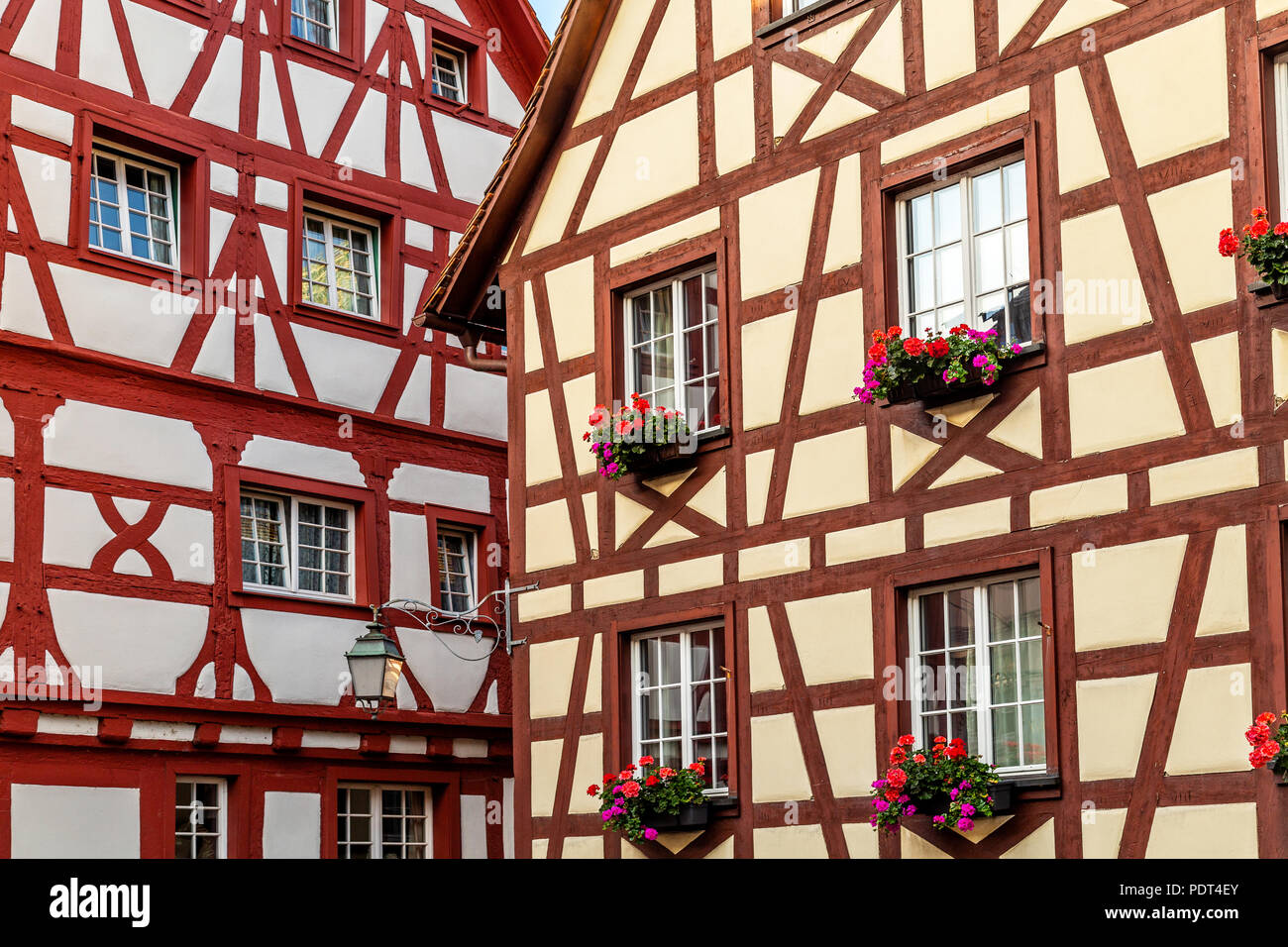 Half-timbered red and white facades of houses in Meersburg, typical example of Fachwerk architecture spread in Germany and France, Strasbourg - Stock Image