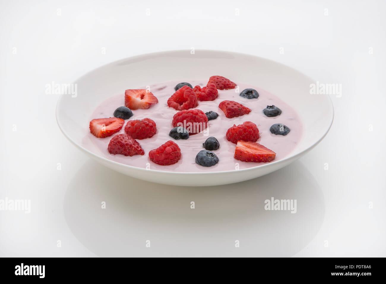 Fresh fruit in yoghurt - Stock Image