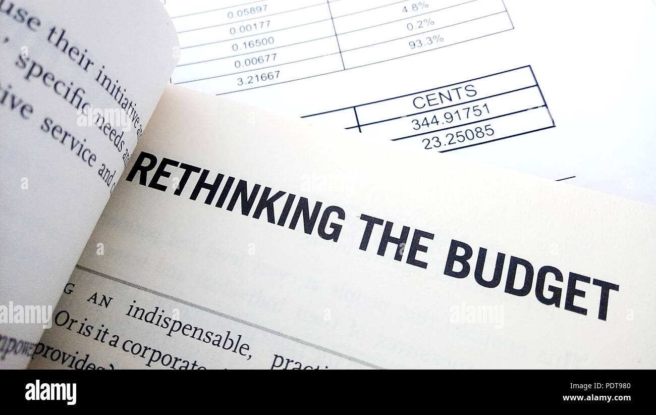 rethinking the budget on book budget planning concept stock photo