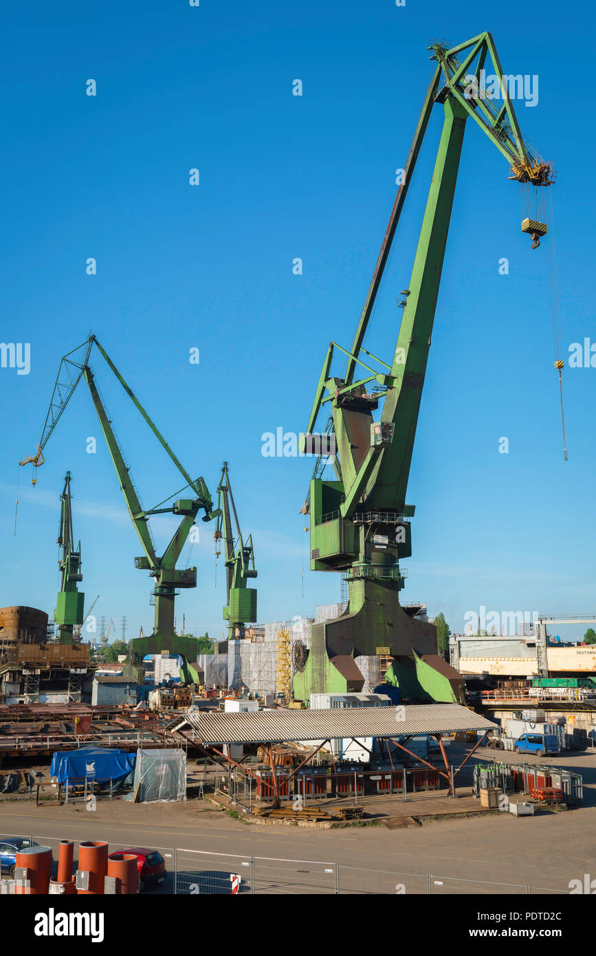 Gdansk Poland, view of huge green cranes sited in the Gdansk Shipyard, focus in the 1980s of  protest and dissent by the Solidarity Movement, Poland. Stock Photo