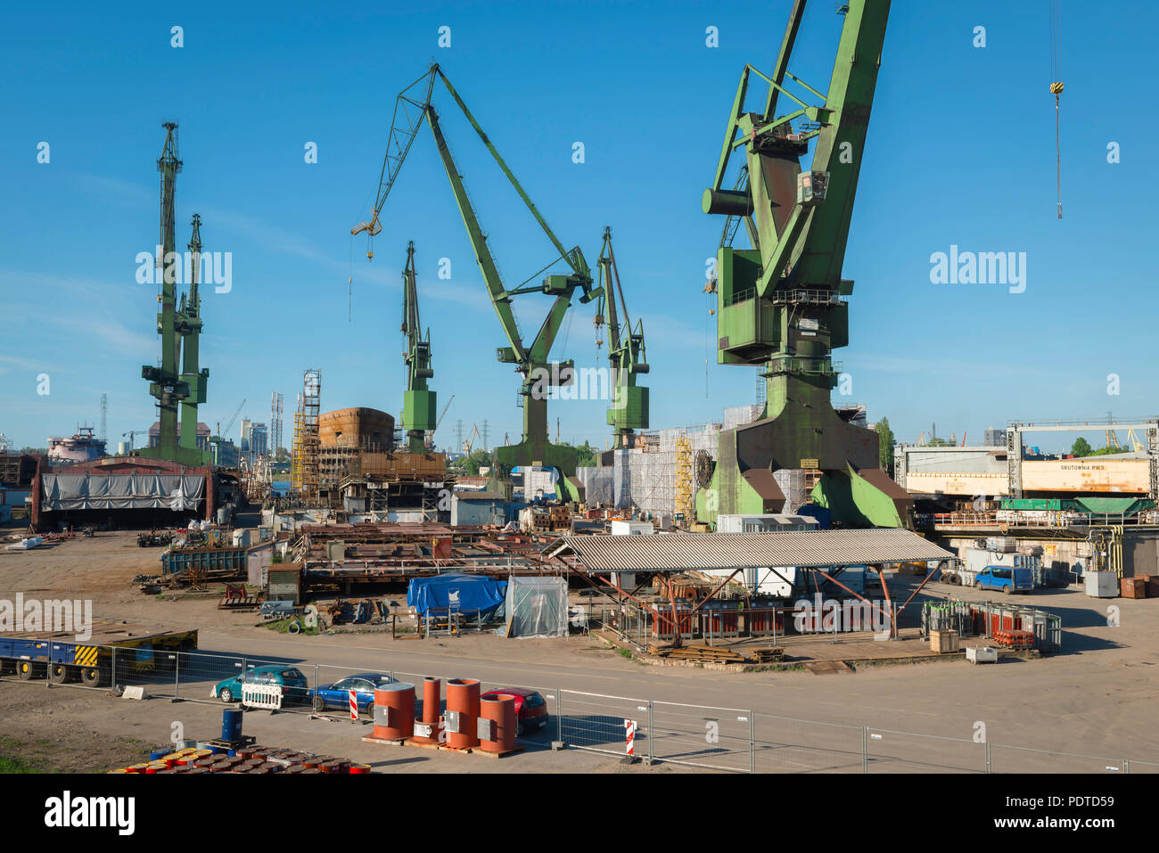 Gdansk shipyard, view of huge green cranes sited in the Gdansk Shipyard, focus in the 1980s of  protest and dissent by the Solidarity Movement, Poland. Stock Photo