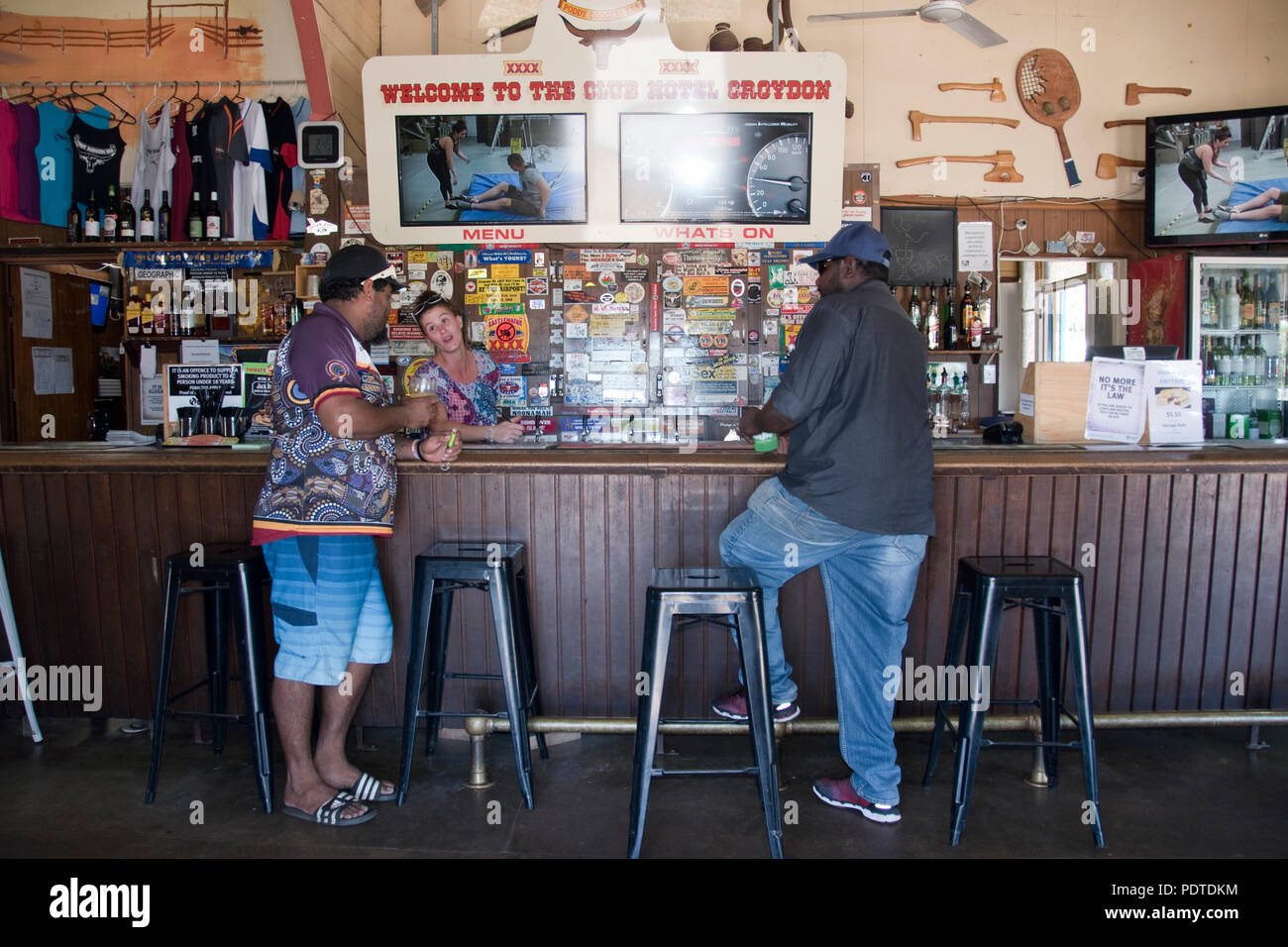 Two aboriginal stockmen, known as ringers in Queensland, drink beer at the Poddy Dodger Bar in the Club Hotel in outback town of Croyden, Queensland. - Stock Image