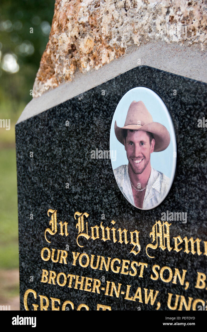 A photo of a young Australian stockman (cowboy) on a gravestone in the cemetery at Georgetown, an Outback town in Queensland, Australia. - Stock Image