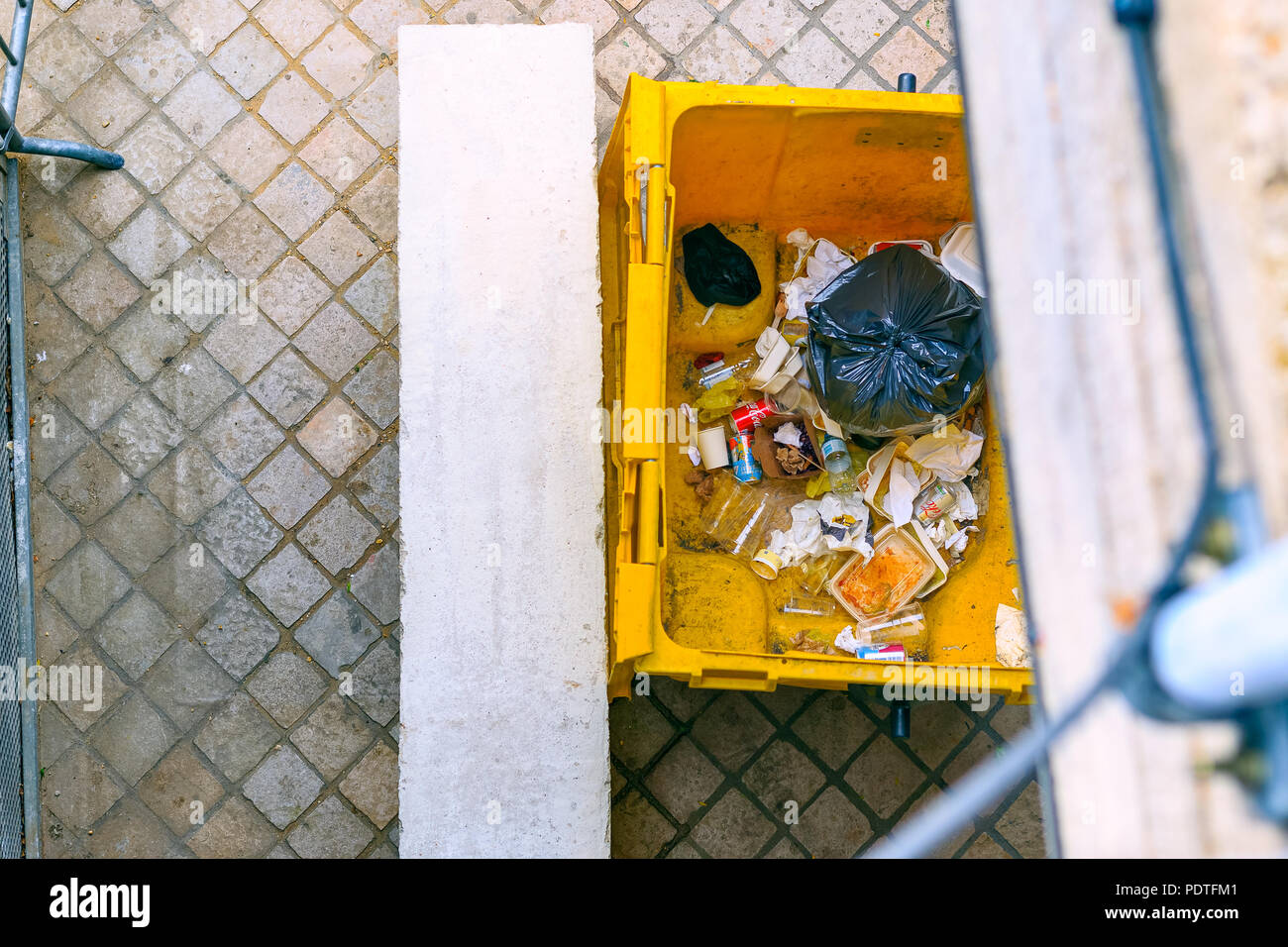 London, UK - August 7, 2018 - Top view of an open rubbish dumpster on street around Southbank Stock Photo