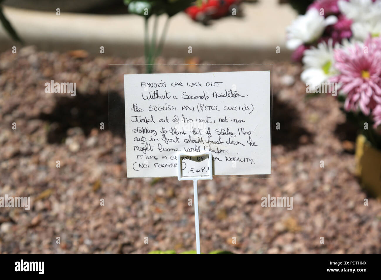 Hand written message left on the grave of British racing driver Peter Collins on the 60th anniversary of his death. - Stock Image