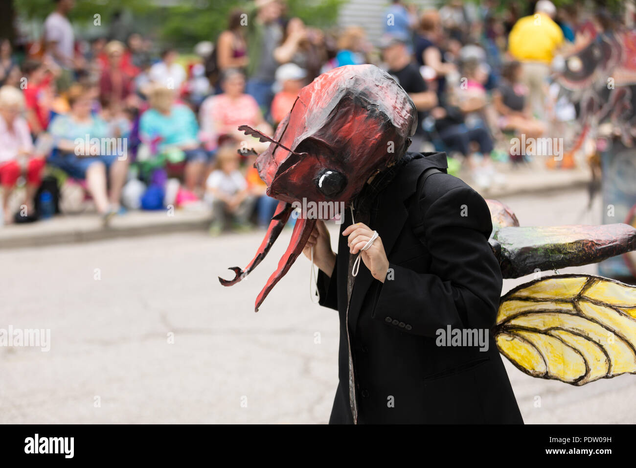 Cleveland, Ohio, USA - June 9, 2018 man dress up as an ant At the abstract art festival Parade The Circle Stock Photo