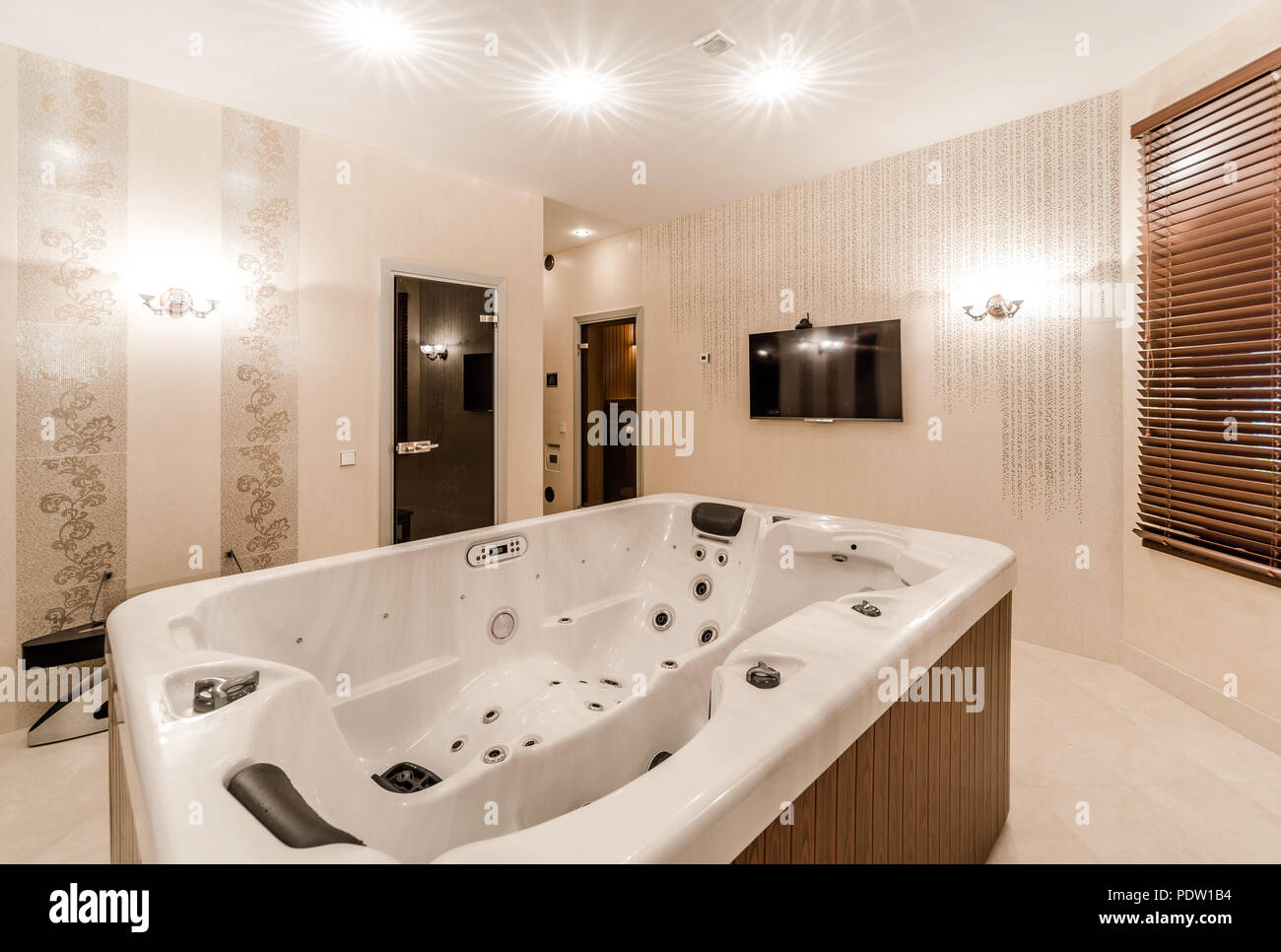 Interior of modern bathroom with jacuzzi stock photo
