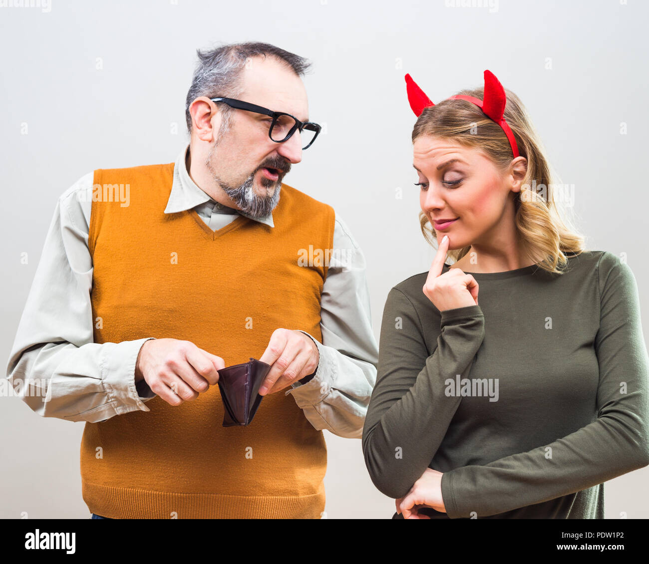 Nerdy man is uncertain,he is thinking does his wife love more him or his money. - Stock Image