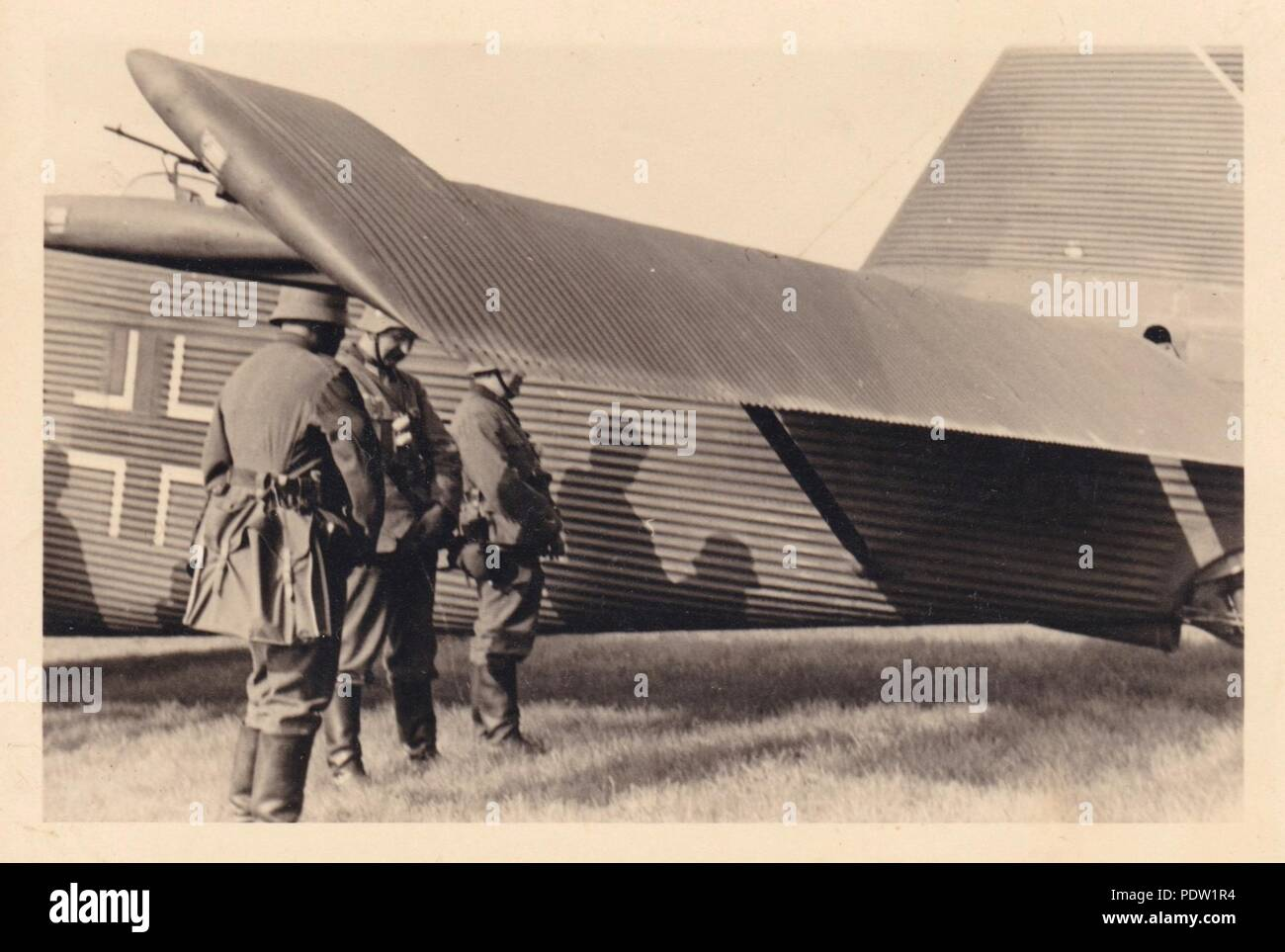Image from the photo album of Oberfeldwebel Karl Gendner of 1. Staffel, Kampfgeschwader 40: German infantrymen take a preflight comfort-break, prior to boarding Junkers Ju 52/3m transport aircraft at Lüben airfield in eastern Germany, en route to Deblin in Poland, September 1939. Karl Gendner was a pilot with 3./KGzbV 9 at this time. - Stock Image