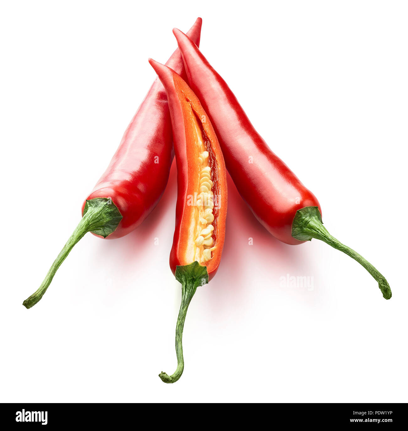 Red hot chili peppers one split isolated on white background as package design element - Stock Image