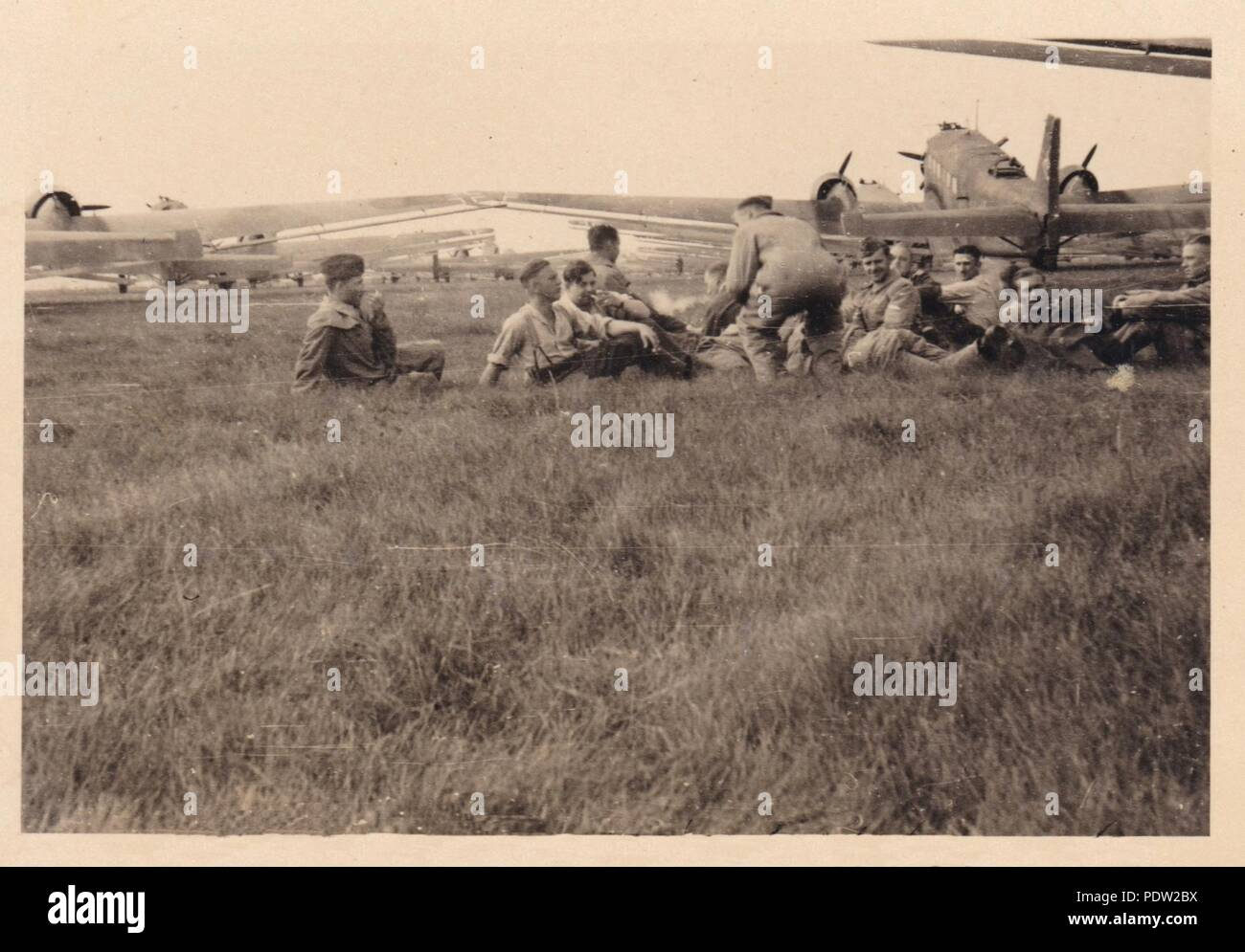 Image from the photo album of Oberfeldwebel Karl Gendner of 1. Staffel, Kampfgeschwader 40: Karl Gendner (third from left) and other transport crewmen from 3./KGzbV 9 relax between missions beside their Junkers Ju52/3m transport aircraft at Brest-Litovsk Airfield, Poland in September 1939. - Stock Image