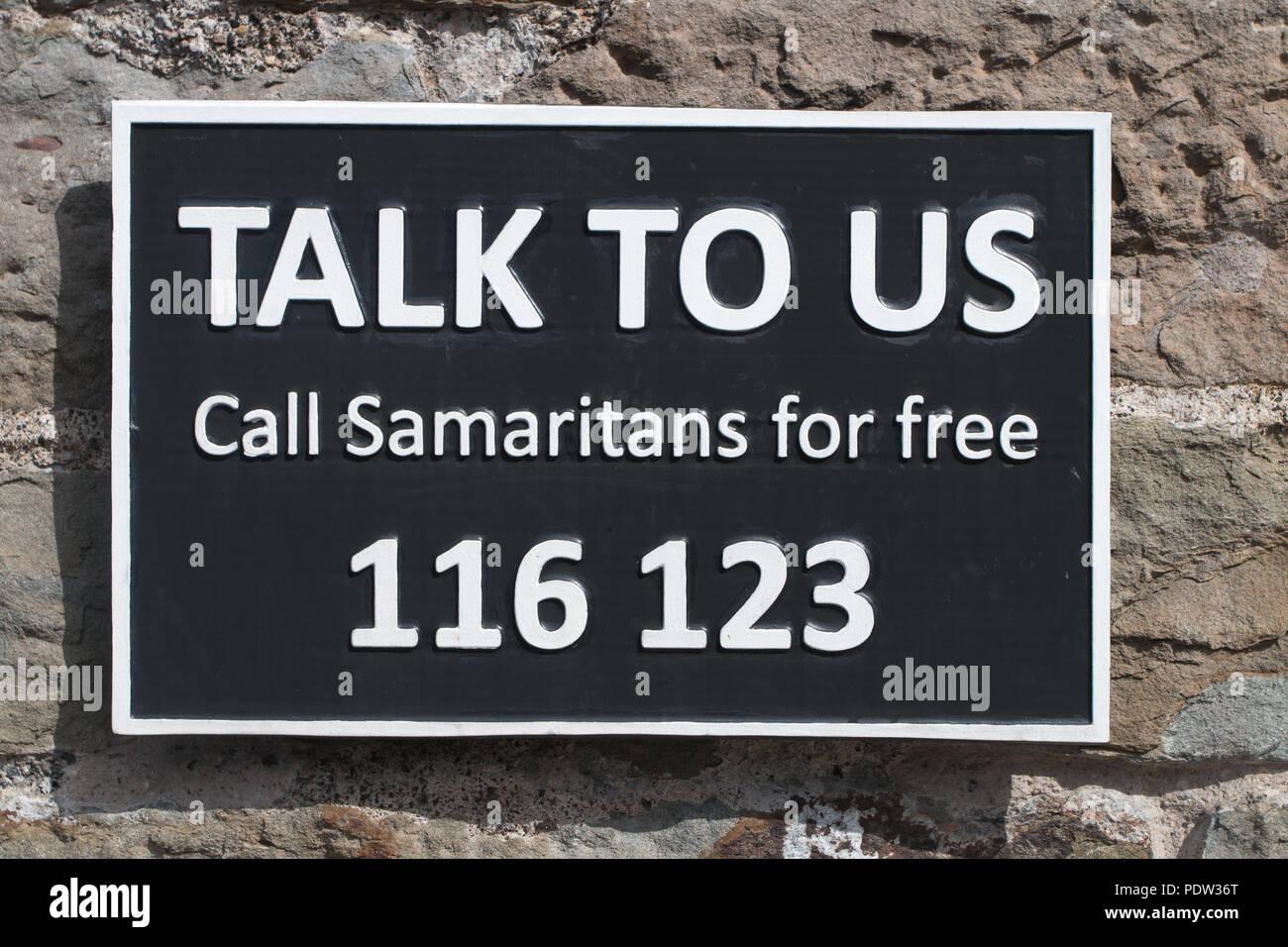 SAMARITANS: Talk To Us - A Sign on Clifton Suspension Bridge Stock Photo