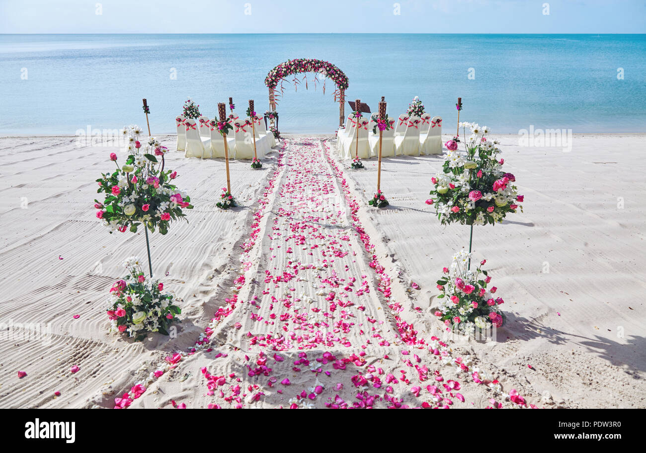 Beach wedding venue setting on the white sand with ...