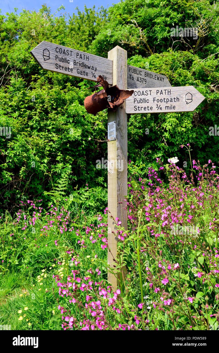 Signpost along the South West Coast Path at Slapton Sands, with attachment (see description). - Stock Image