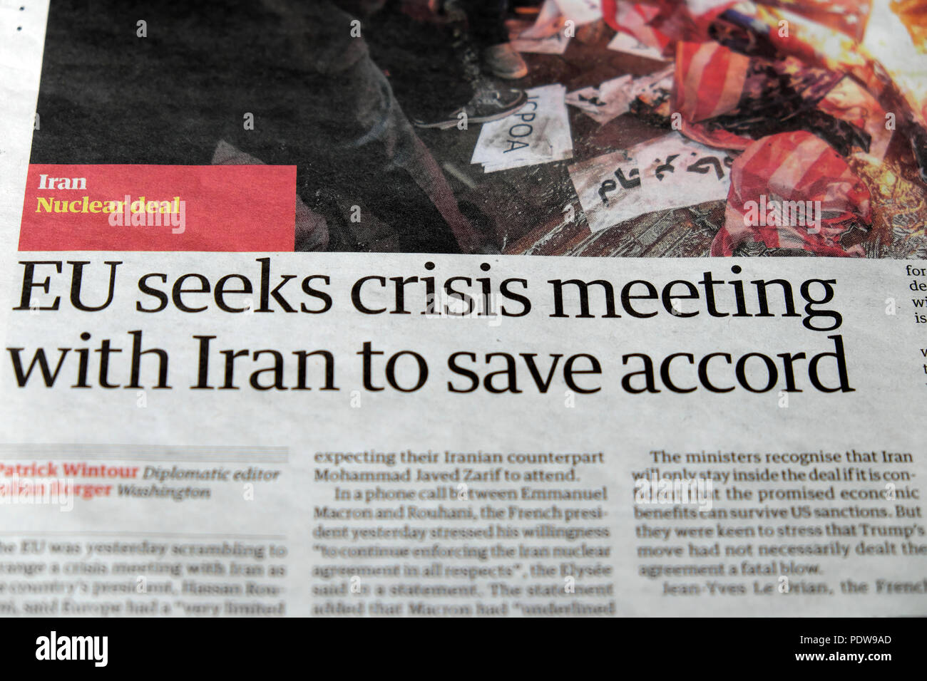 'EU seeks crisis meeting with Iran to save accord' Iran nuclear deal newspaper headline in the Guardian paper in London UK - Stock Image