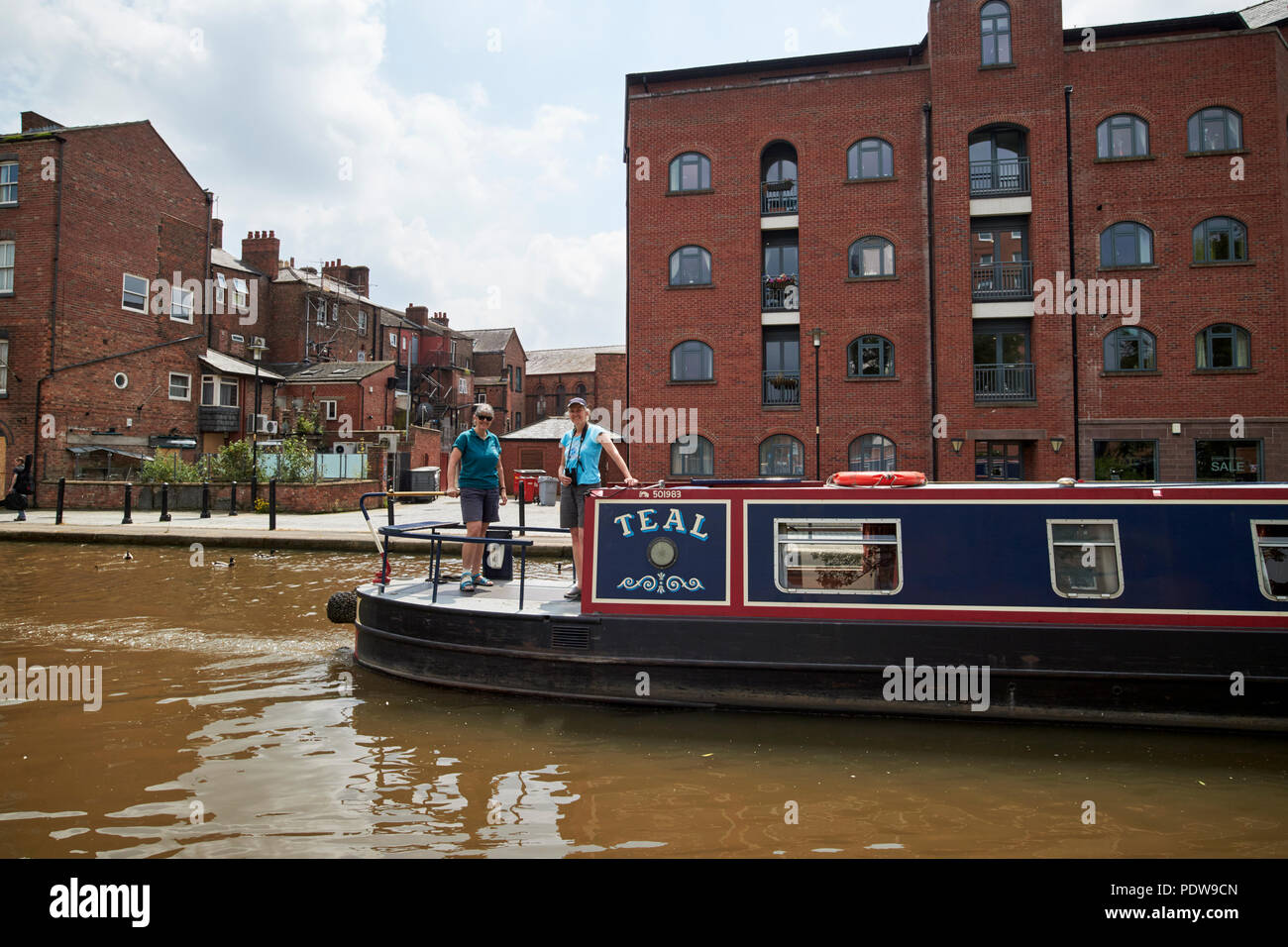 two women on a narrowboat on the Shropshire union canal main line in chester cheshire england uk - Stock Image