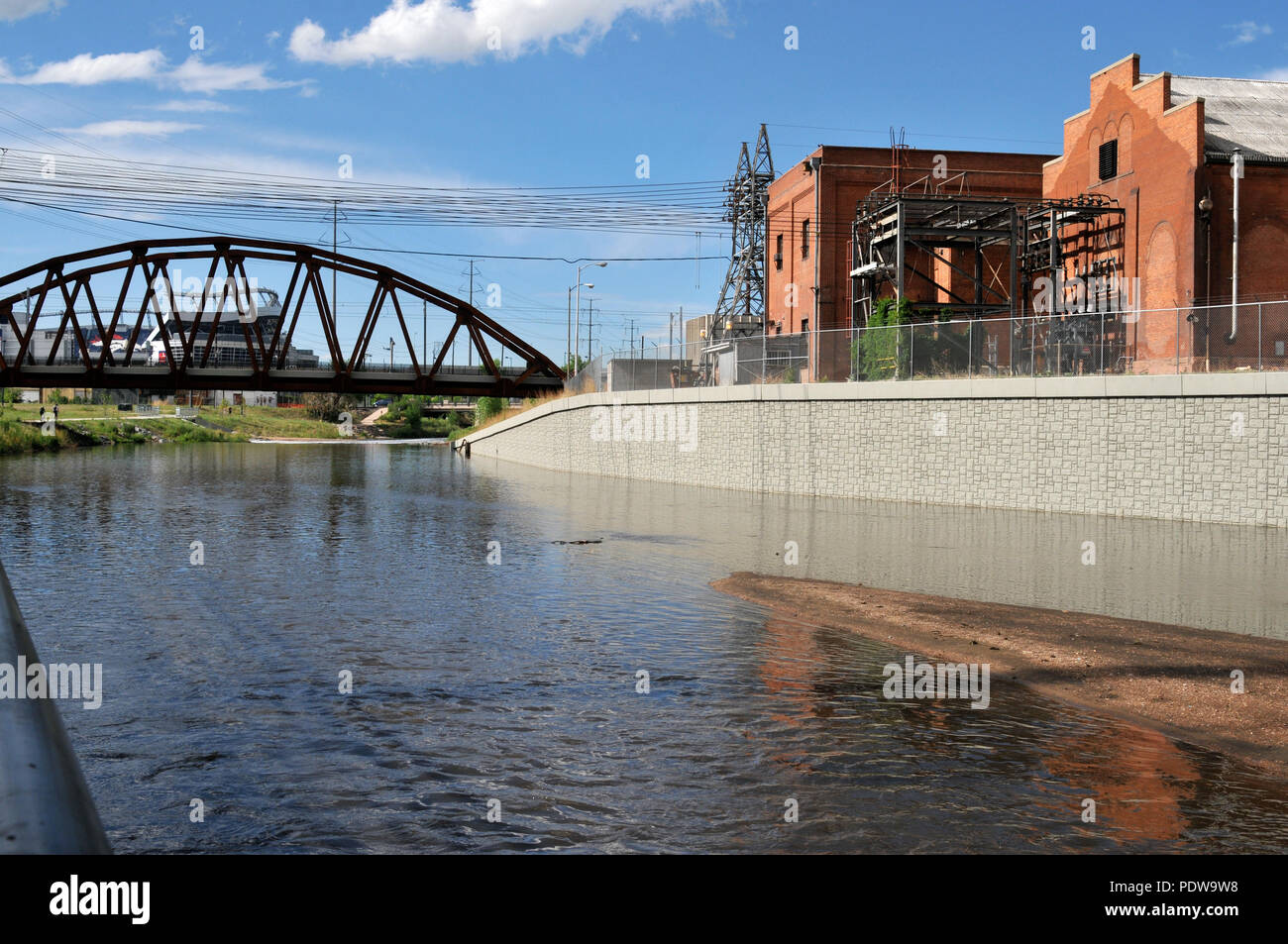 The power plant along the South Platte River in Denver, with Invesco Field in the background,  Exclusive Denver Stock Photos. - Stock Image