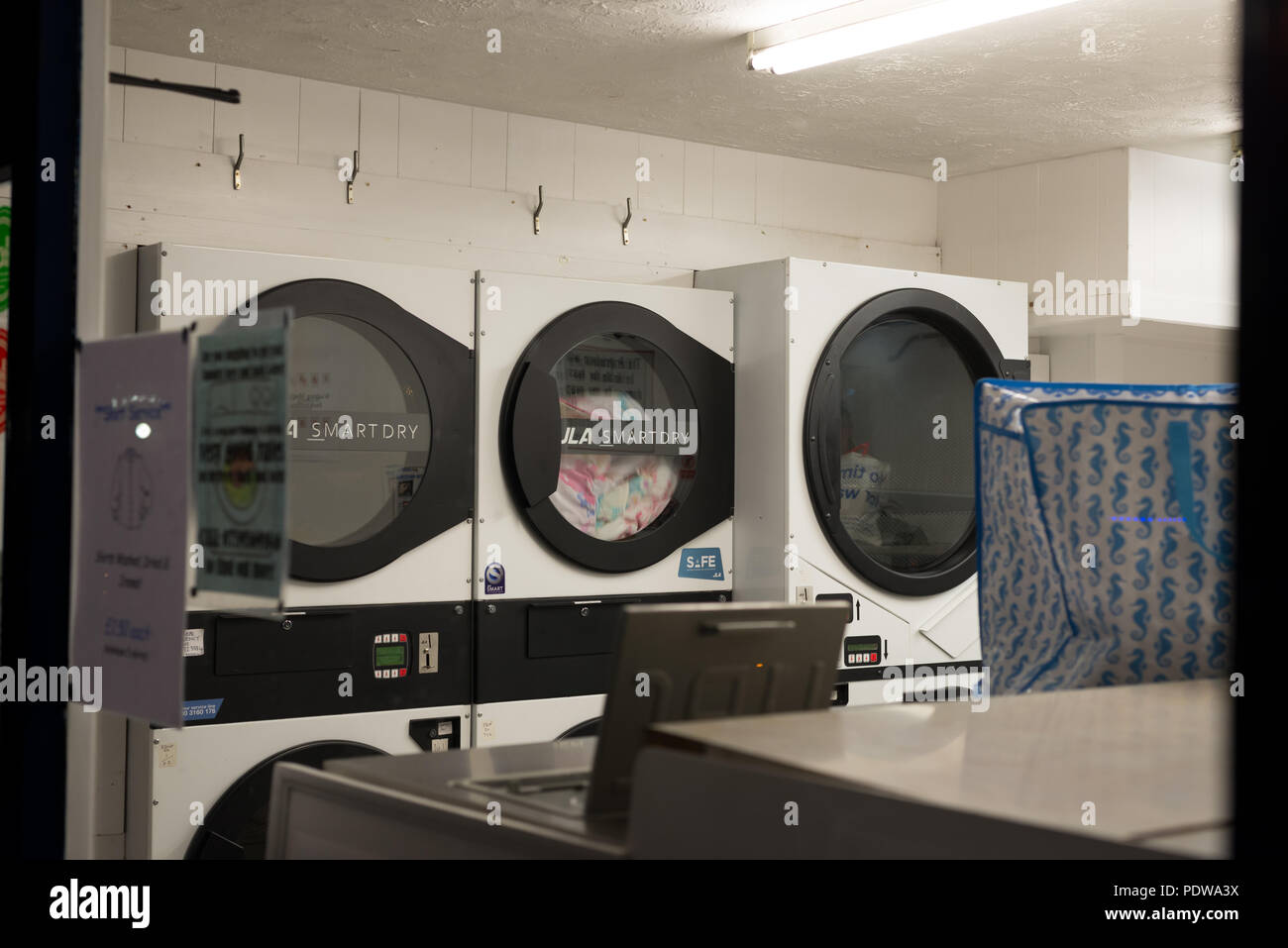 Laundrette, Chipper Lane, Salisbury, Wiltshire, England at night - Stock Image