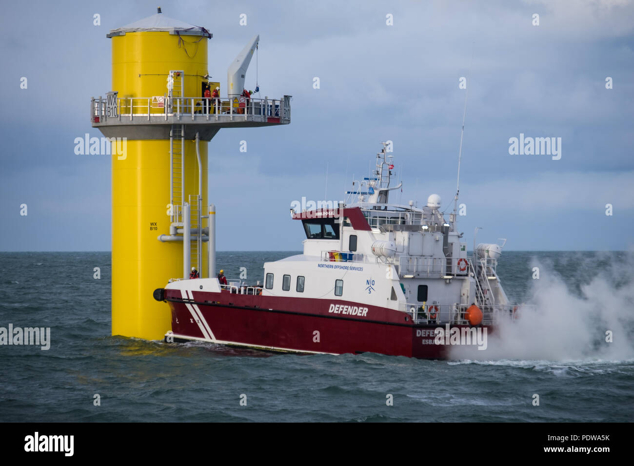 The crew transfer vessel, Defender, working on the Walney Extension Offshore Wind Farm - Stock Image