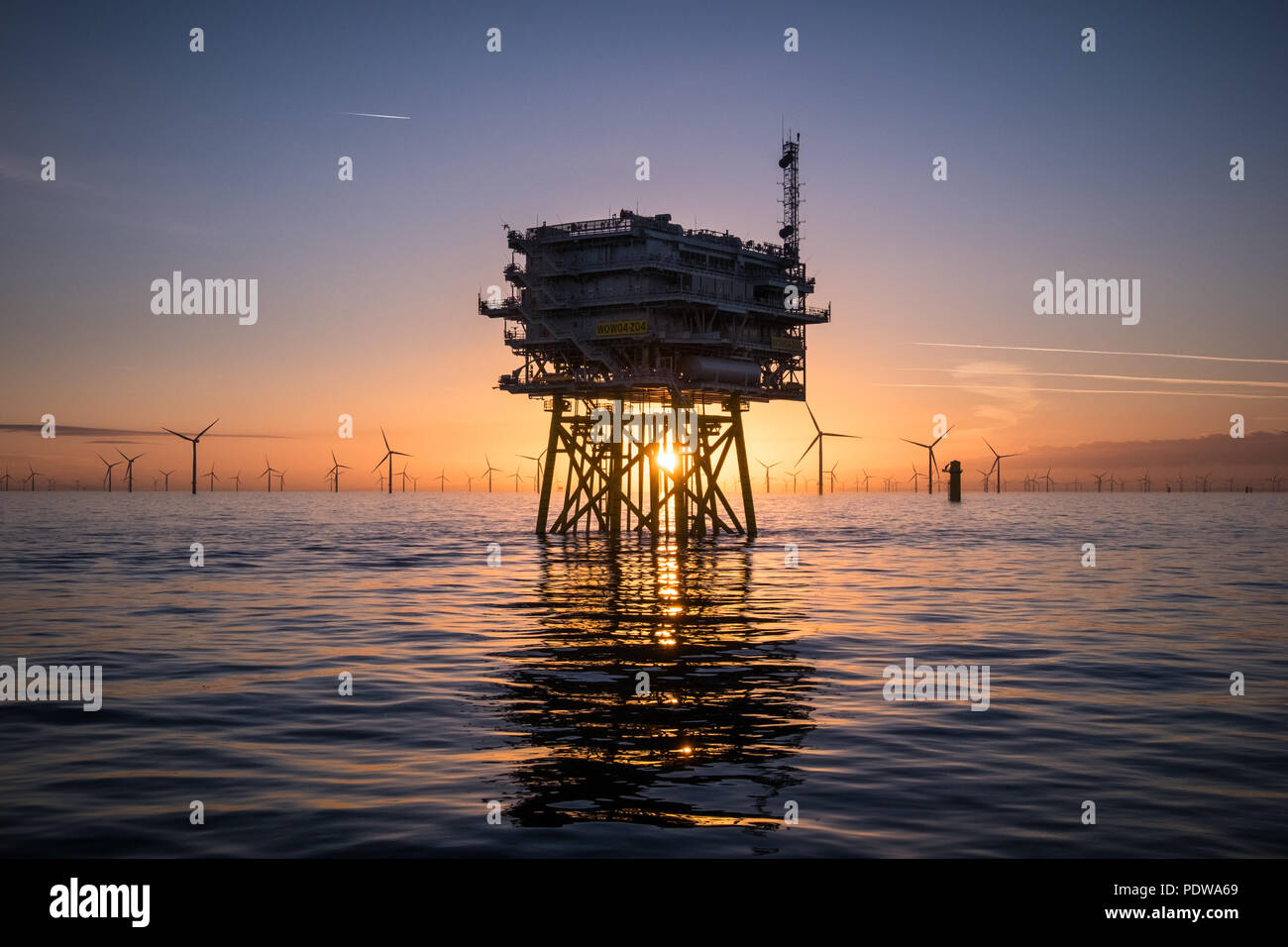 Walney Extension Offshore Wind Farm at sunrise - Stock Image