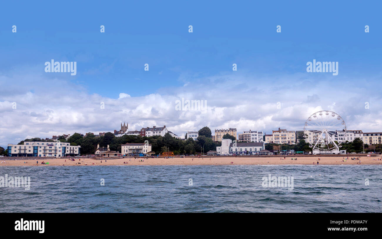 Panoramic view of Exmouth, with Holy Trinity church, and the Exmouth Wheel on the seafront beside the beach - Stock Image