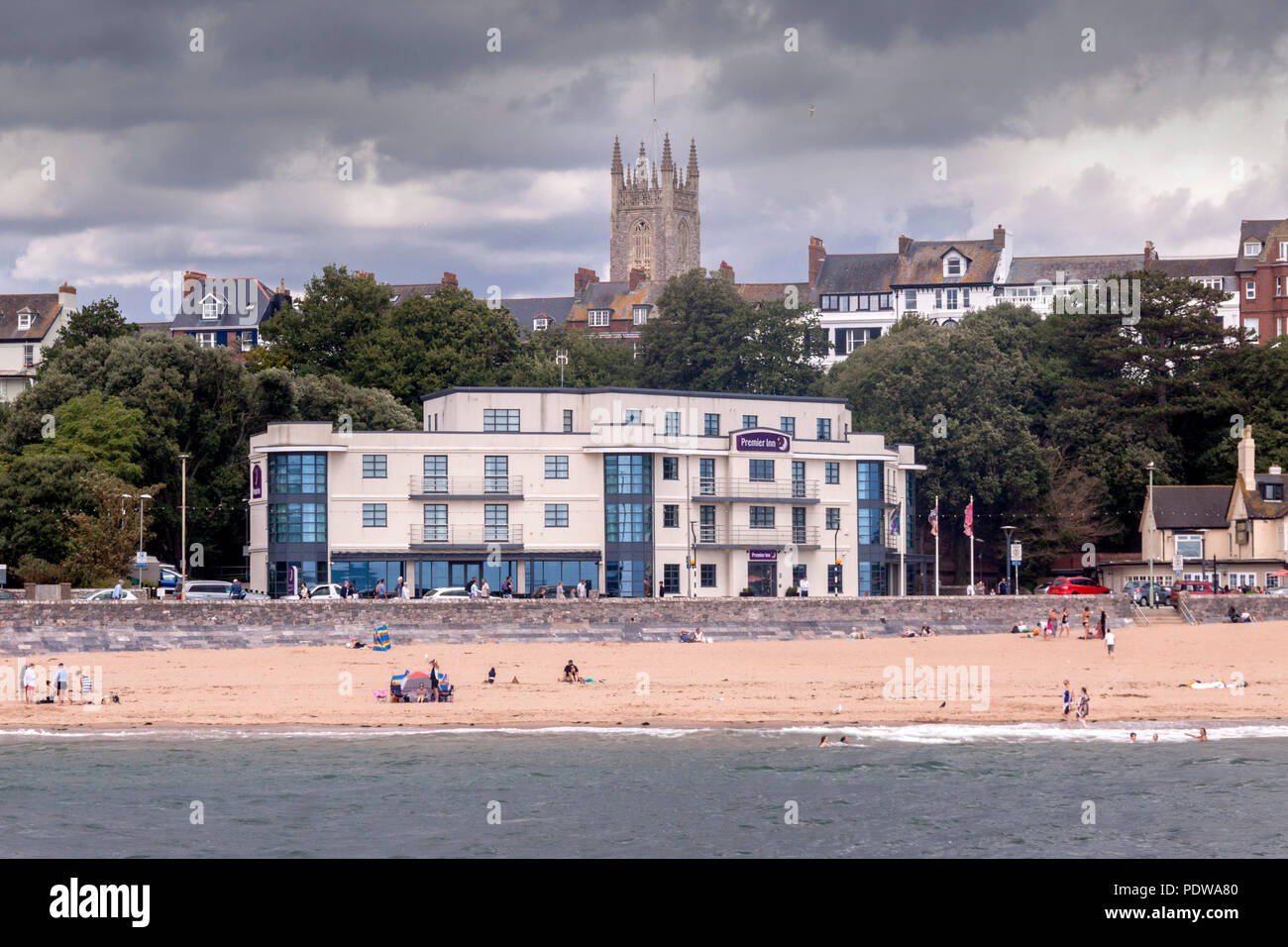 View of Exmouth, with Holy Trinity church, and the Premier Inn on the seafront beside the beach - Stock Image