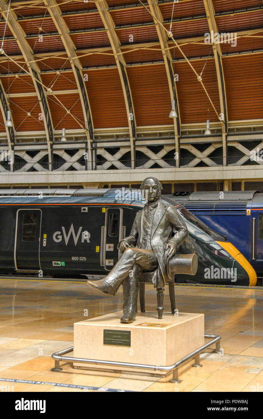 Statue of Isambard Kingdom Brunel  on London Paddington railway station with a new Great Western Railway train in the background Stock Photo