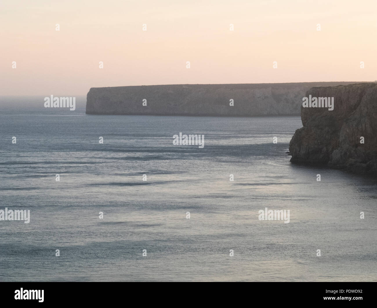 solitary beach during the early sunrise morning. noone walking out there, silence and peace feeling - Stock Image