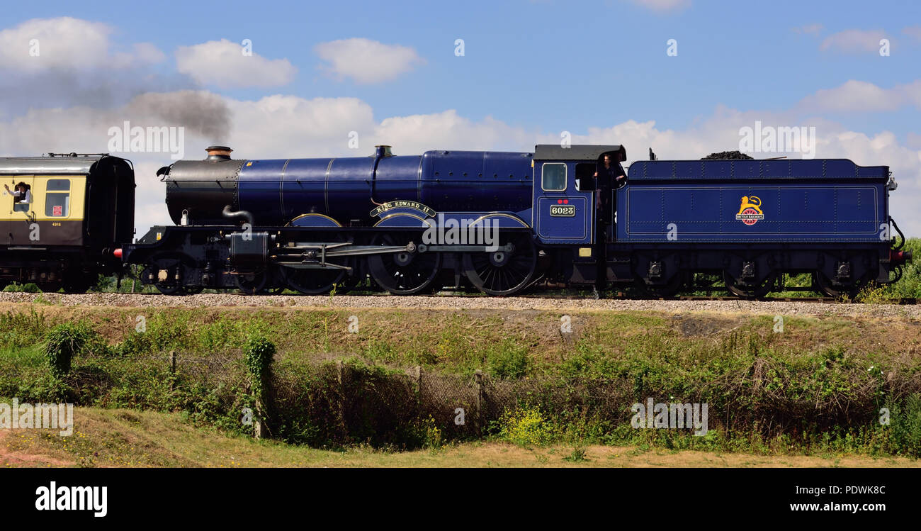 Steam train arriving at Goodrington on the Dartmouth Steam Railway, hauled by GWR King Class locomotive No 6023 King Edward II, running tender first. Stock Photo
