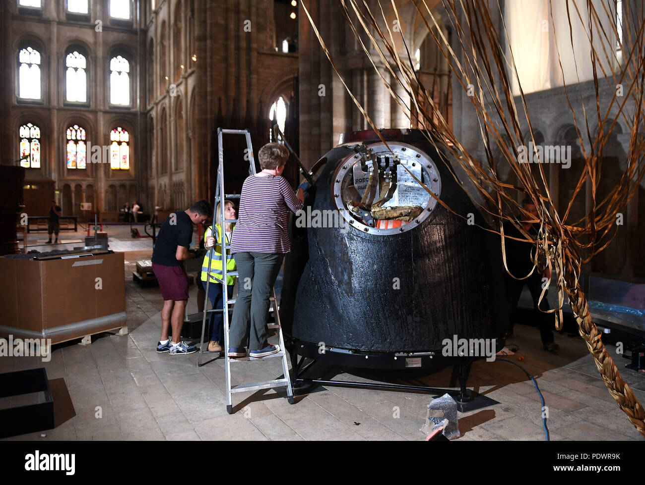 The Soyuz TMA-19M descent module, the spacecraft which brought astronaut Tim Peake back to Earth after his mission to the International Space Station, goes on display at Peterborough Cathedral. - Stock Image
