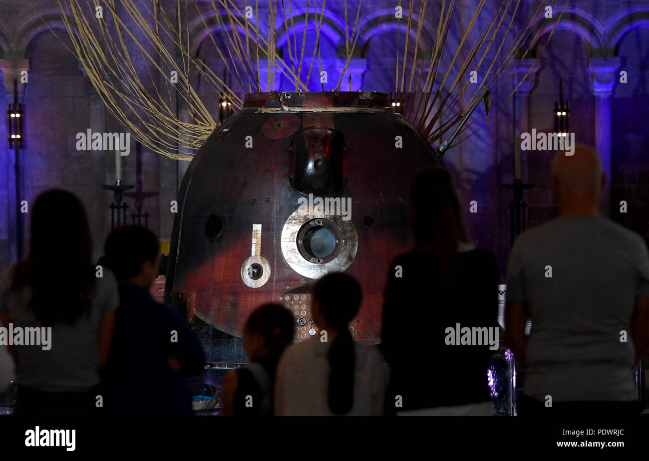 People view the Soyuz TMA-19M descent module, the spacecraft which brought astronaut Tim Peake back to Earth after his mission to the International Space Station, as it goes on display at Peterborough Cathedral. - Stock Image