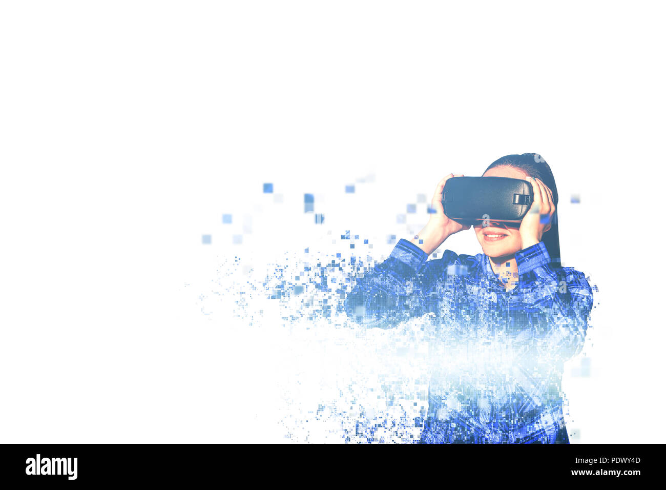 The woman with glasses of virtual reality. Future technology concept. Modern imaging technology. Fragmented by pixels - Stock Image
