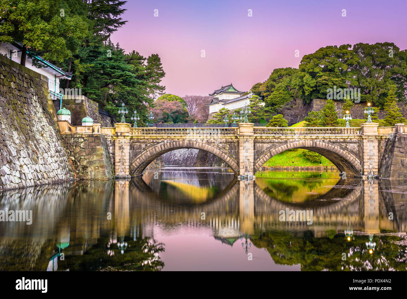 Tokyo, Japan at the Imperial Palace moat and bridge at dawn. - Stock Image