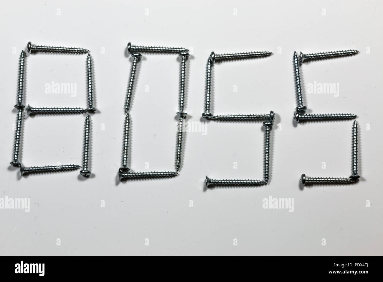 The word BOSS written with screws on white background - Stock Image
