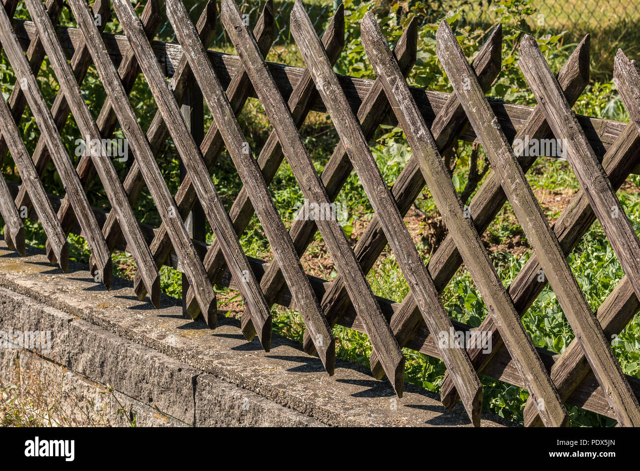 Wooden fence as safety device - Stock Image