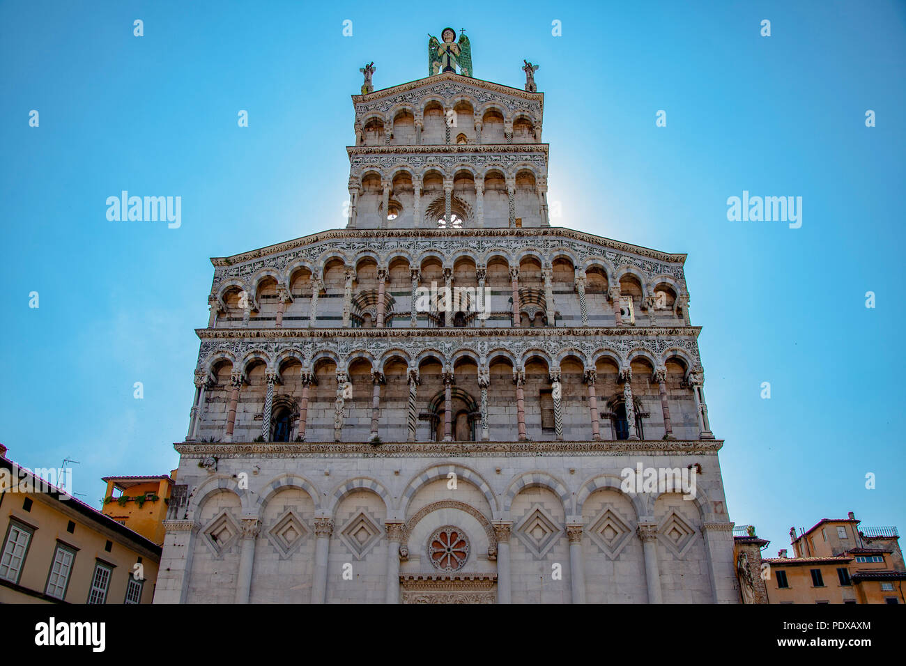 A backlit of the San Michele in Foro church façade, at Lucca (Tuscany) which represents the most exuberant and light in the Italian Romanesque style. - Stock Image