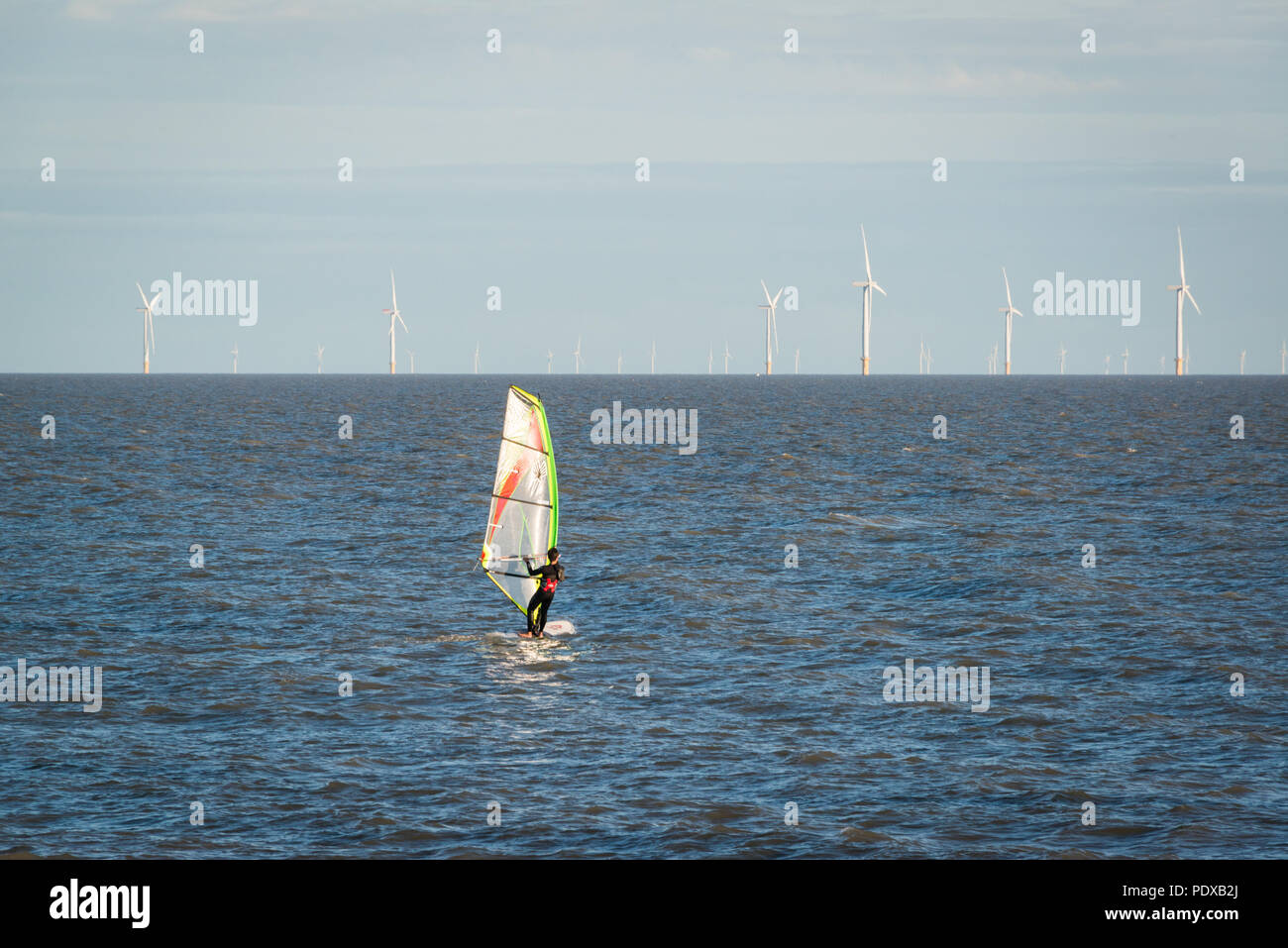 A windsurfer in the water at Clacton on Sea, Essex, UK - Stock Image