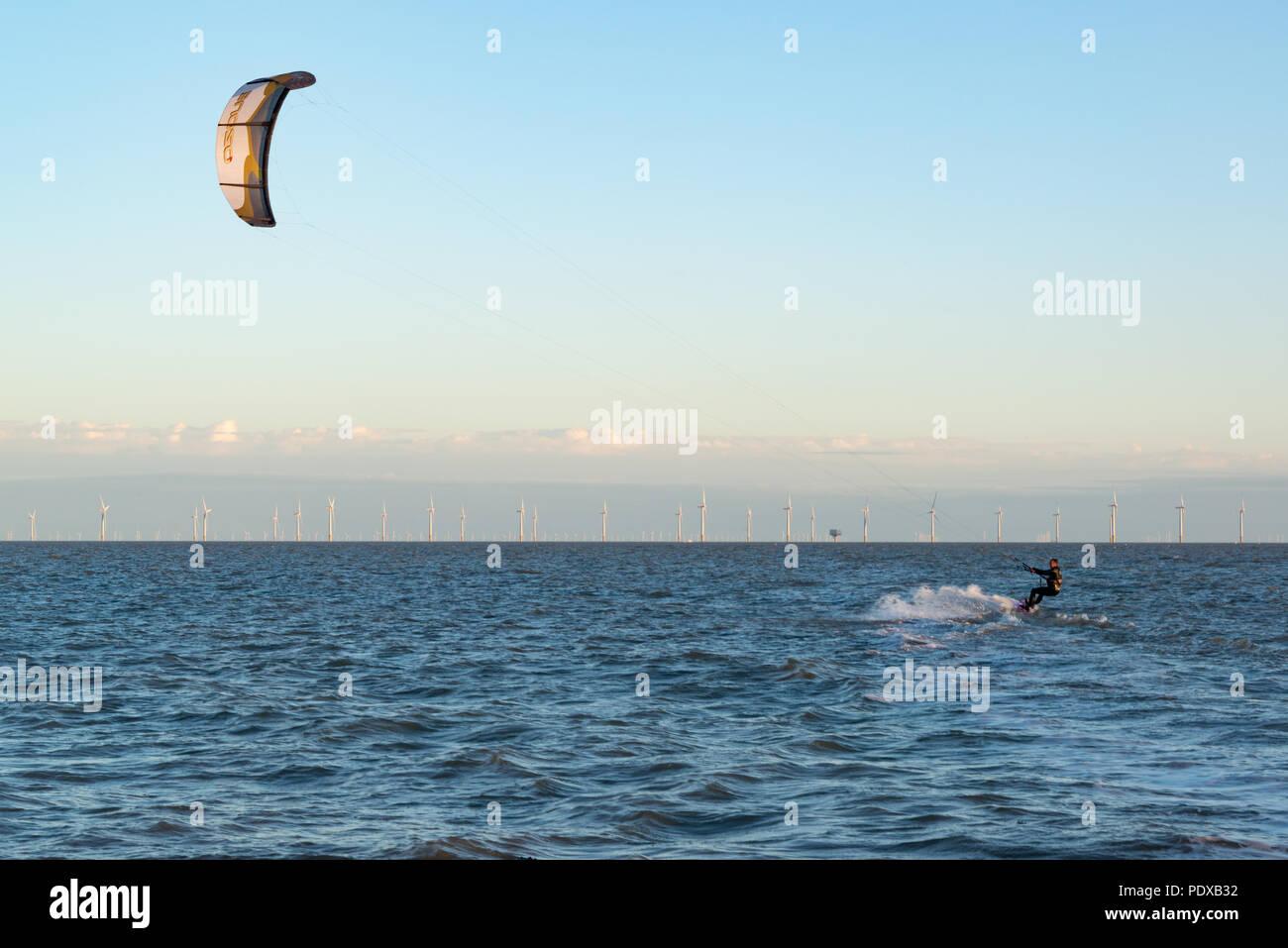 A kite surfer in the sea near Clacton-on-Sea, Essex - Stock Image