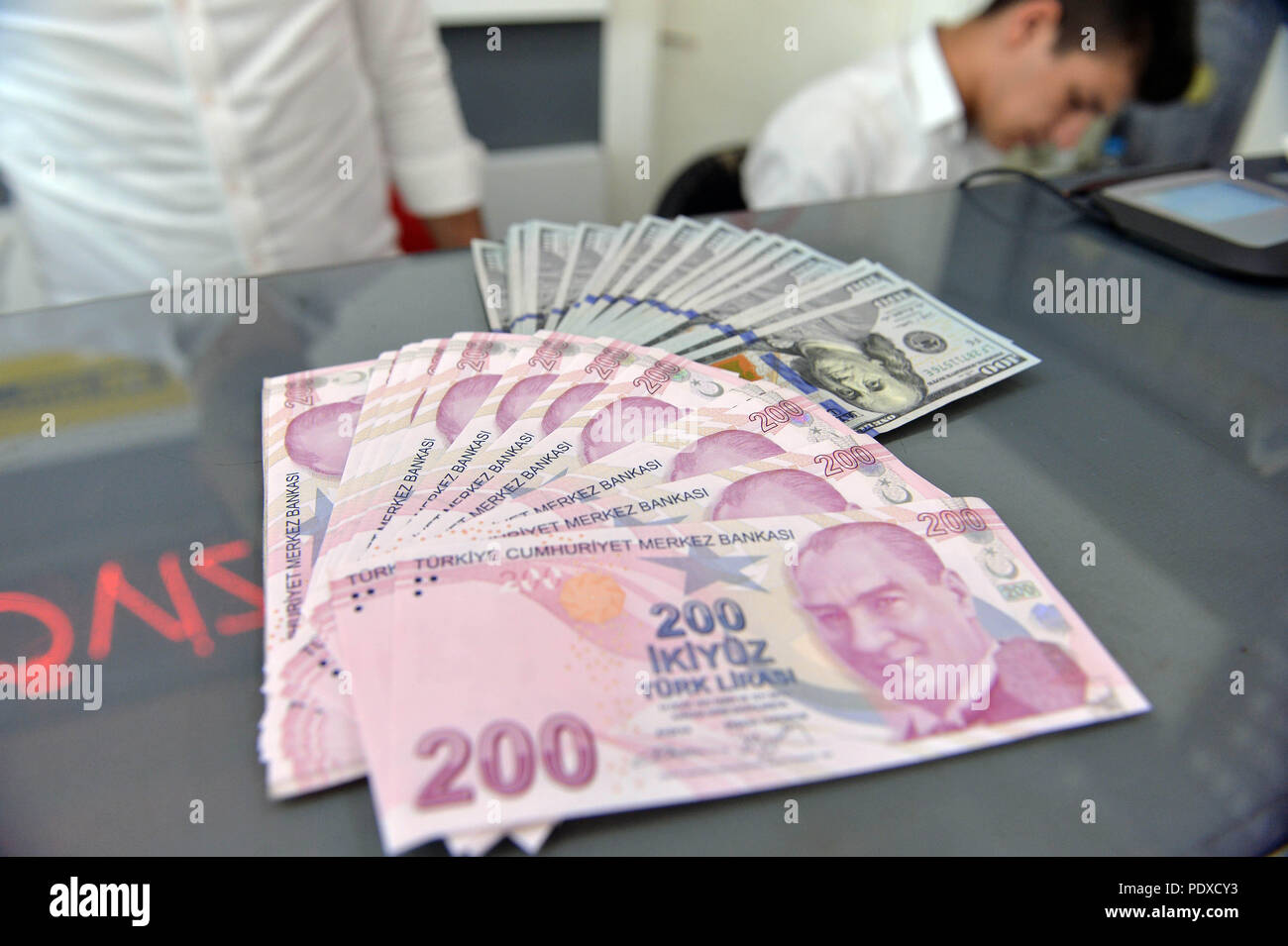 Ankara, Turkey. 10th Aug, 2018. A money changer shows U.S. Dollar and Turkish Lira banknotes at a currency exchange office in Ankara, Turkey, on Aug. 10, 2018. The Turkish lira on early Friday hit an all-time low of 6.30 against the U.S. dollar, a day after a deadlock in bilateral talks in Washington which aimed to resolve political crisis between Turkey and the United States. Credit: Mustafa Kaya/Xinhua/Alamy Live News Stock Photo
