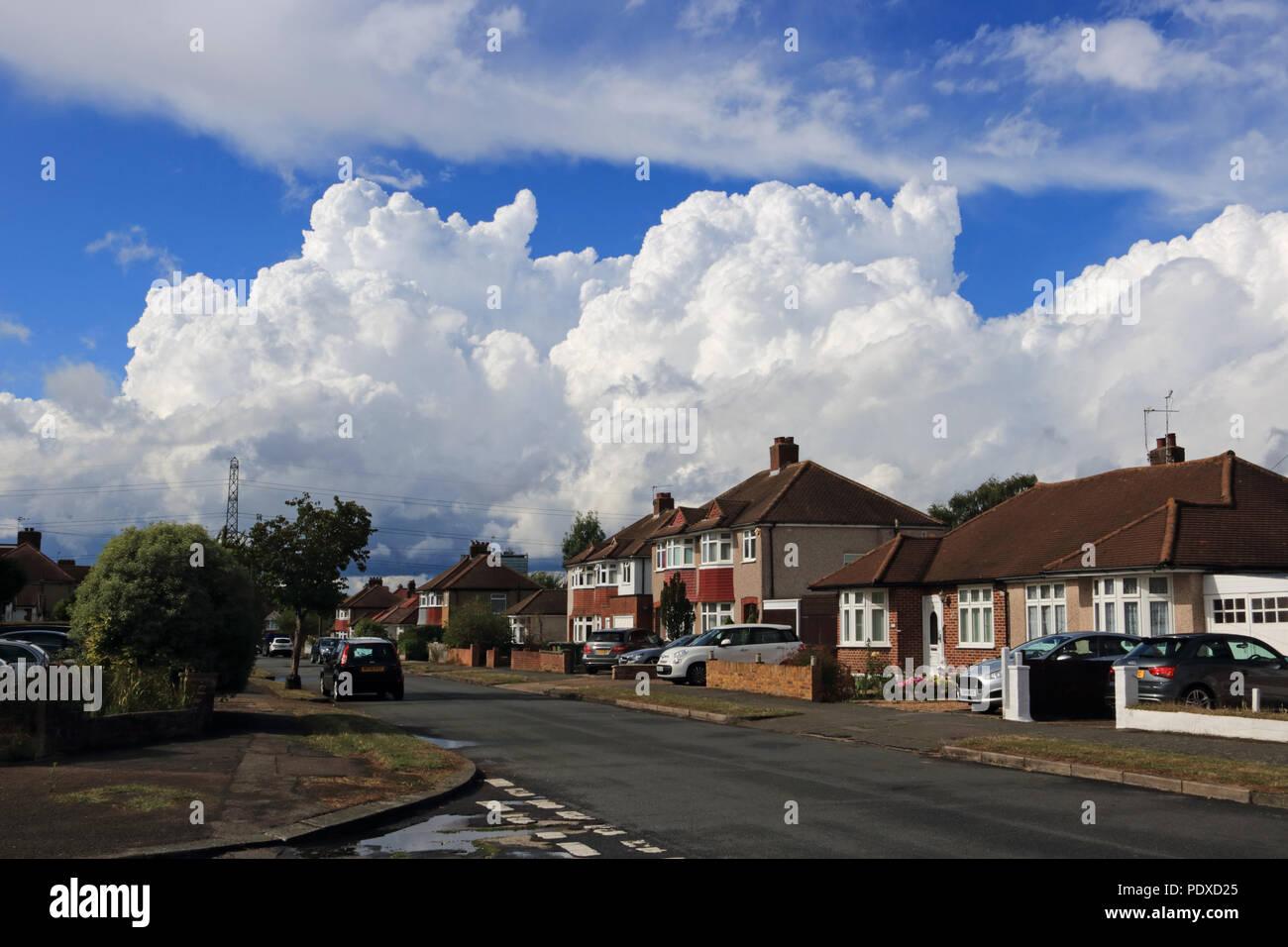 Epsom Surrey England UK. 10th August 2018. Towering cumulonimbus rain clouds fill the sky over a suburban street in Epsom Surrey. Credit: Julia Gavin/Alamy Live News - Stock Image