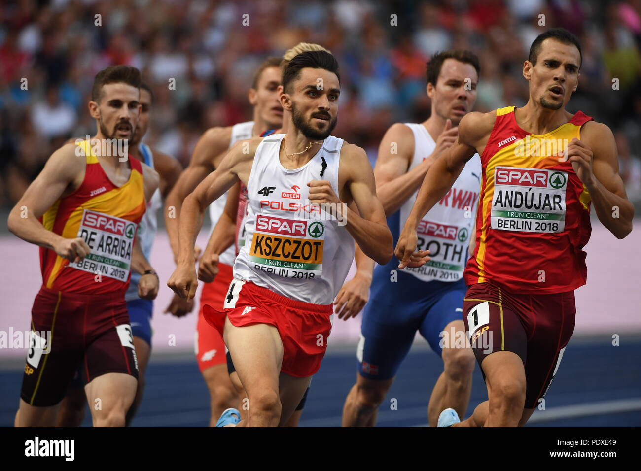 Berlin, Germany. 10th Aug, 2018. Athletics, European Championships in the Olympic Stadium, 800 m, Men, Semi-final: Adam Kszczot (c) from Poland, Daniel Andujar (r) from Spain in action. Credit: Hendrik Schmidt/dpa-Zentralbild/dpa/Alamy Live News - Stock Image