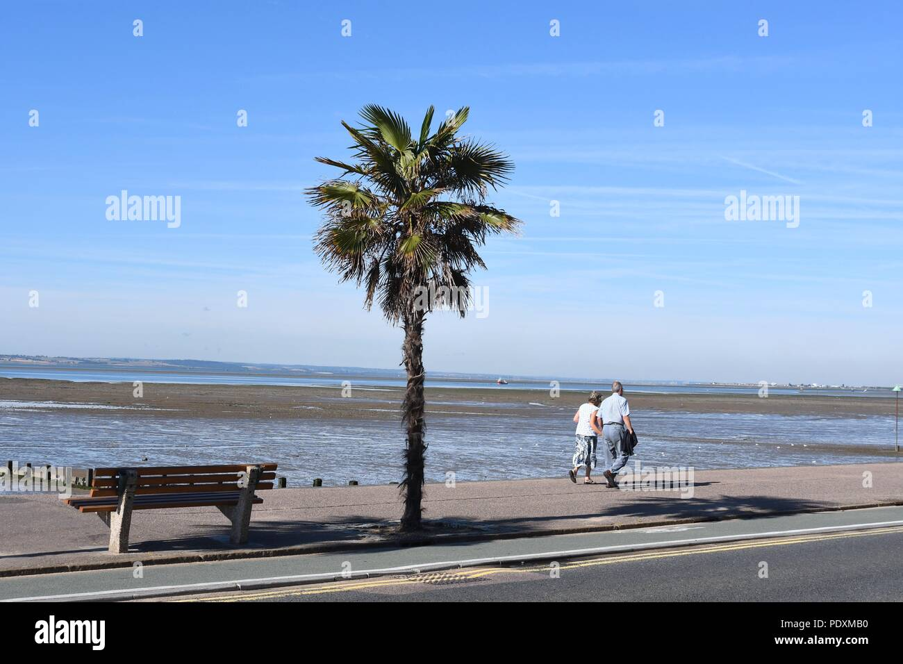 Southend-on-Sea, Essex, UK. 11th August, 2018. UK Weather: A warm start to the day in Southend - a view of people walking along the sea front Credit: Ben Rector/Alamy Live News - Stock Image