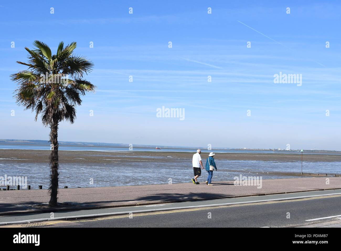 Southend-on-Sea, Essex, UK. 11th August, 2018. UK Weather: A warm start to the day in Southend - a view of people walking along the sea front Credit: Ben Rector/Alamy Live News Stock Photo