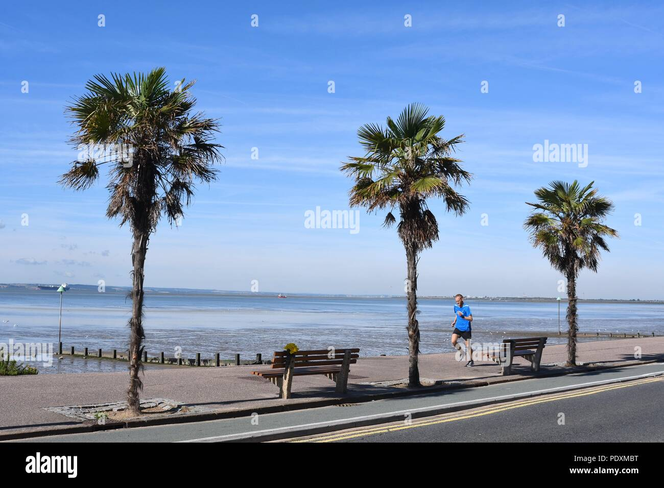 Southend On Sea Es Uk 11th August 2018 Uk Weather A Warm Start To The Day In Southend A View Of A Man Jogging Along The Sea Front Credit Ben