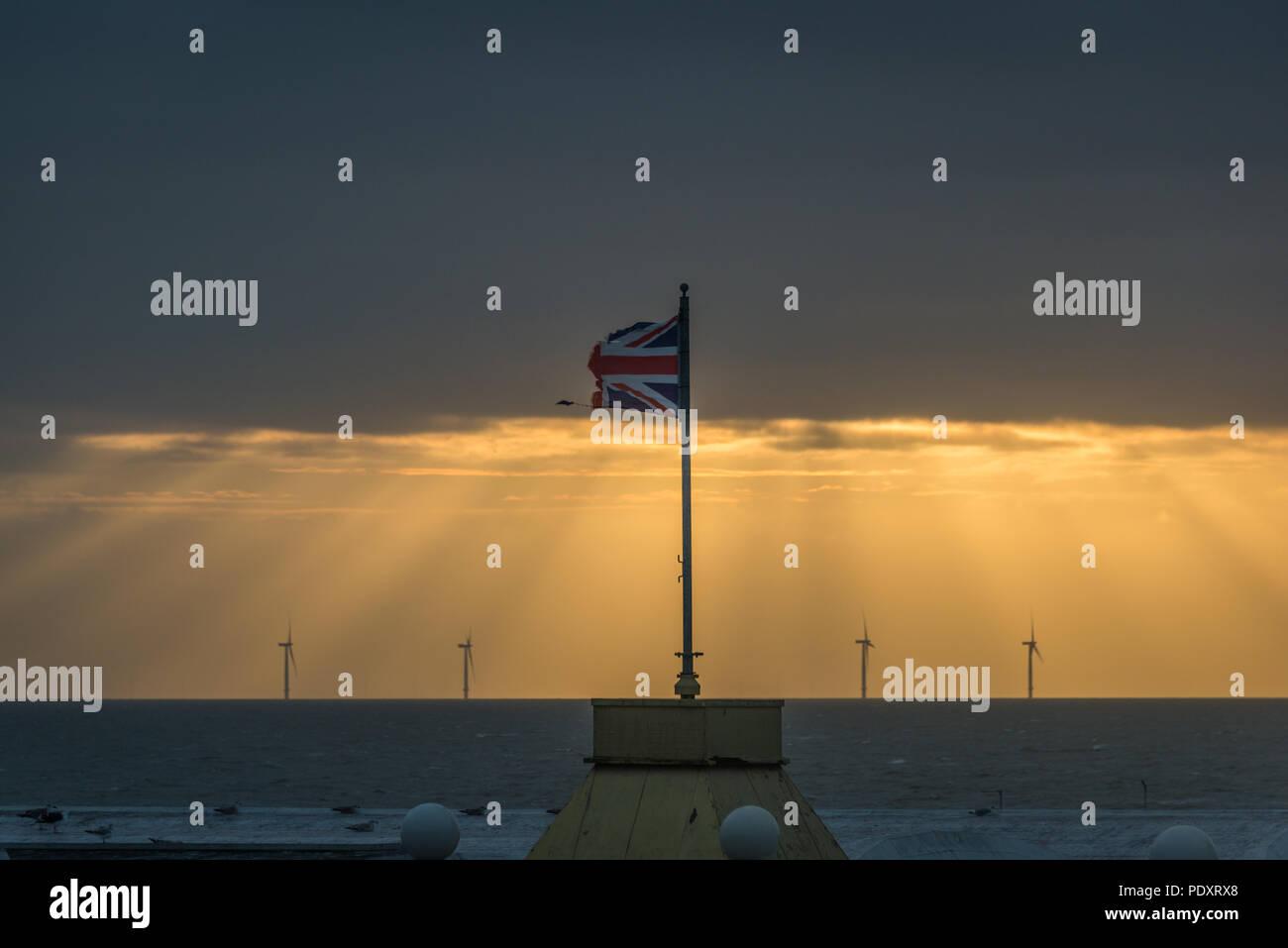 A weather-beaten Union Jack flag, Clacton-on-Sea, Essex, UK - Stock Image