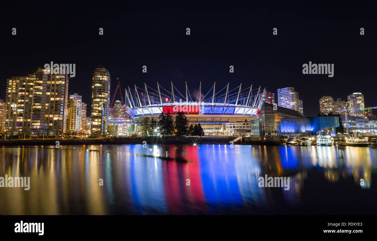 VANCOUVER, BC, CANADA - NOV 16,2015: BC Place, in False Creek, displaying the French tricolore as a show of support in the week following the attacks in Paris. - Stock Image