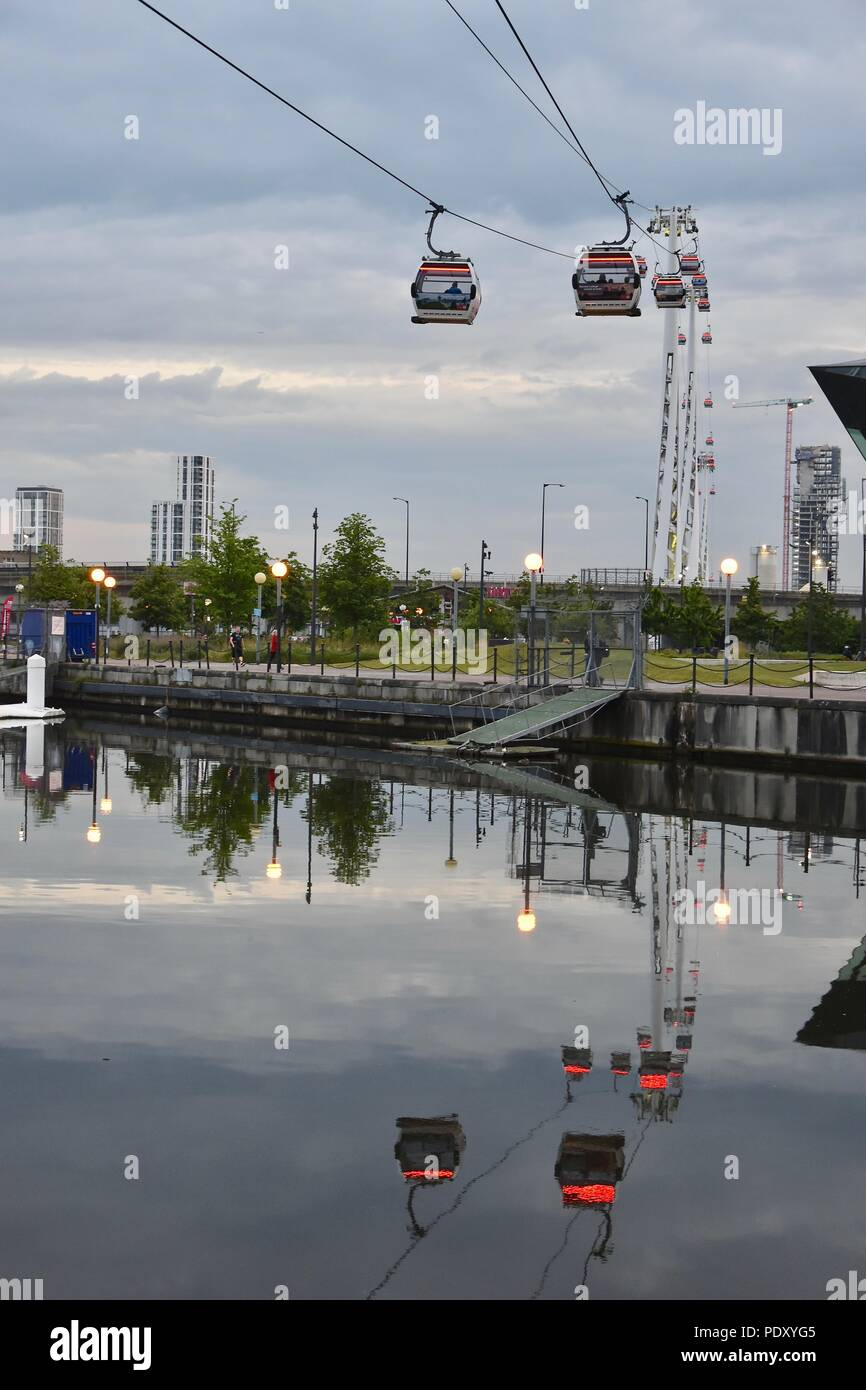 A view of the London Canary Wharf skyline and Emirates Air Line as seen from Royal Victoria Dock, Beckton, London, UK - Stock Image