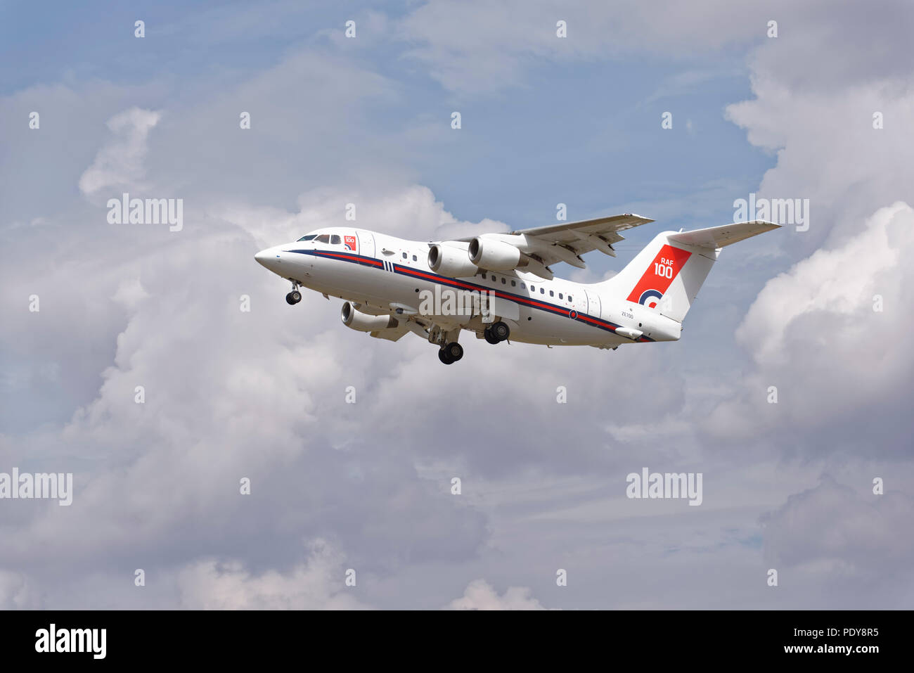 British Royal Air Force four engined transport aircraft a BAE 146 departs RAF Fairford after attending the Royal International Air Tattoo - Stock Image