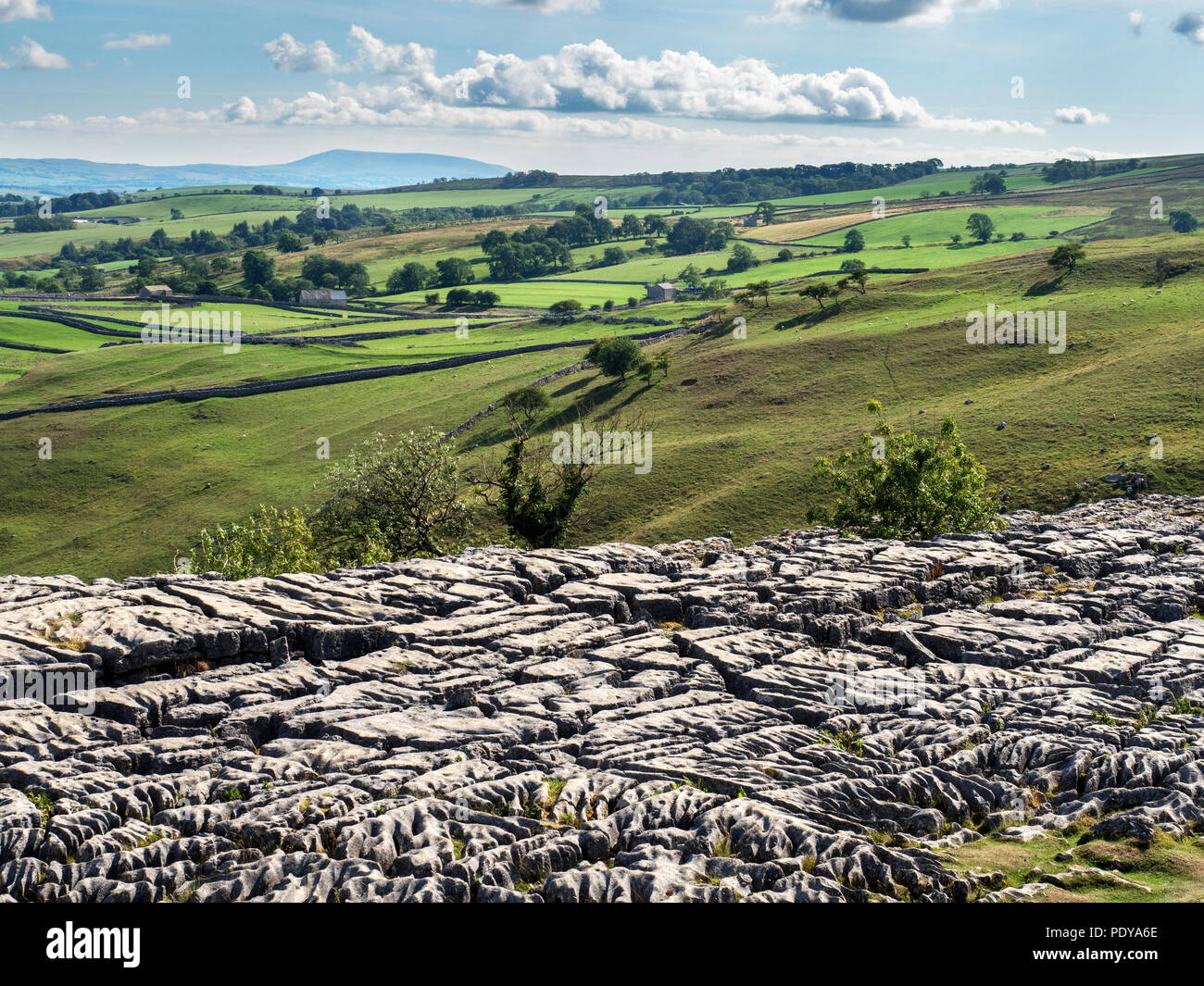 View from Malham Cove with Pendle Hill on the horizon near Malham Yorkshire Dales England Stock Photo
